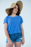 Beautiful woman in blue top and hat Stock Photography
