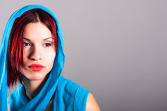 Beautiful woman with a blue veil. Portrait of beautiful woman with a blue veil royalty free stock images