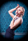 Beautiful woman on blue vintage background Royalty Free Stock Photos