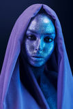 Beautiful woman in blue and violet bodyart with glitters Royalty Free Stock Images