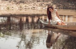 Beautiful woman in boat Royalty Free Stock Photos