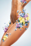 Beautiful woman body in blue and yellow flowers Royalty Free Stock Photography