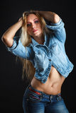 Beautiful woman body in jeans Stock Photos