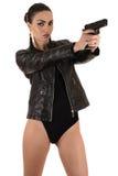 Beautiful woman in bodysuit aiming a gun Royalty Free Stock Photography