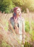 Beautiful woman in boho style enjoy sunlight Stock Photography