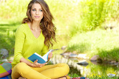 Beautiful woman  with book Royalty Free Stock Image
