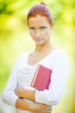 Beautiful woman with book Stock Images