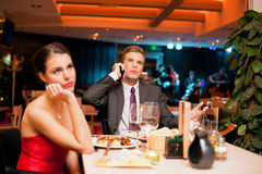 Beautiful woman on boring dating Royalty Free Stock Images