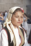 Beautiful woman of Bosnia folk group. POLIZZI GENEROSA, SICILY - AUGUST 19: Beautiful Women of Bosnia folk group and sicilian men at the International Festival stock photo
