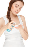 Beautiful woman with a bottle of a cream Royalty Free Stock Image