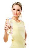 Beautiful woman with a bottle of fresh water Stock Photos