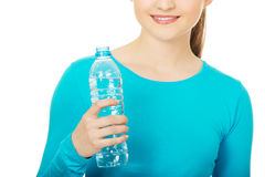 Beautiful woman with bottle of mineral water. Royalty Free Stock Photography