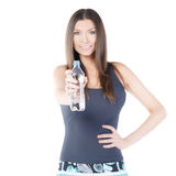 Beautiful woman with bottle of mineral water Royalty Free Stock Photography