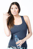 Beautiful woman with bottle of mineral water Royalty Free Stock Images