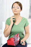 Beautiful woman with bottle of perfume Royalty Free Stock Images