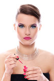 Beautiful woman with bottle of pink nail polish Stock Photos