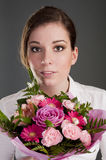 Beautiful woman with bouquet Royalty Free Stock Images