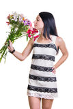 Beautiful Woman with a bouquet of colorful flowers Royalty Free Stock Photography
