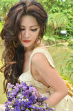 Beautiful woman with bouquet of flower Royalty Free Stock Photo
