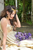 Beautiful woman with bouquet of flower Royalty Free Stock Image