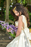 Beautiful woman with bouquet of flower Stock Photos