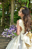 Beautiful woman with bouquet of flower Stock Photography
