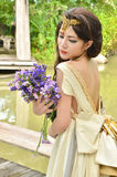 Beautiful woman with bouquet of flower Stock Images