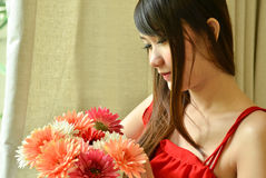 Beautiful woman with bouquet flowers Royalty Free Stock Photos