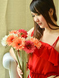 Beautiful woman with bouquet flowers Stock Photography