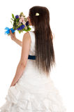 Beautiful woman with a bouquet of flowers is standing back Stock Photography