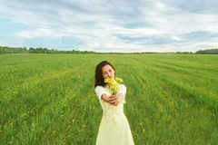 Beautiful woman with bouquet of flowers in summer Royalty Free Stock Image