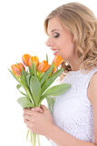 Beautiful woman with bouquet of orange tulips isolated on white Royalty Free Stock Photos