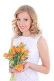 Beautiful woman with bouquet of orange tulips and jewelry gift b Stock Image