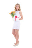 Beautiful woman with bouquet of orange tulips and present isolat Stock Images