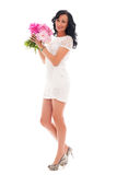 Beautiful woman with bouquet of peonies Stock Image