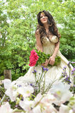Beautiful woman with bouquet of pink rose Stock Photo