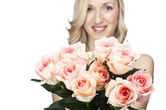 Beautiful woman with a bouquet of pink roses. Beautiful woman with a large bouquet of lovely fresh pink roses in her arms, a gift for Valentines Day, anniversary Stock Photography