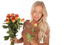 Beautiful woman with a bouquet of roses Stock Image