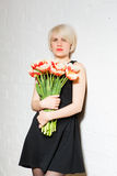 Beautiful woman with a bouquet of roses Stock Photography
