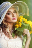 Beautiful woman with a bouquet Royalty Free Stock Photo