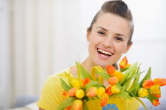Beautiful woman with bouquet of tulips Stock Images