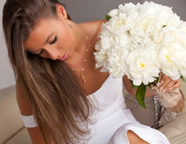 Beautiful woman with bouquet of white peonies. Stock Photography