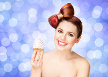 Beautiful woman with a bow haircut holding a cake Royalty Free Stock Photography
