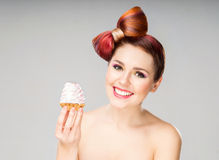 Beautiful woman with a bow haircut holding a cake Stock Photos