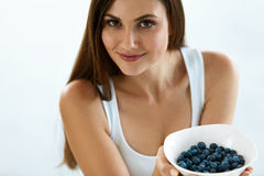 Beautiful Woman With Bowl Of Blueberries. Healthy Diet Nutrition. Woman On Healthy Diet. Closeup Portrait Of Beautiful Smiling Young Female With Bowl Of Tasty royalty free stock photography