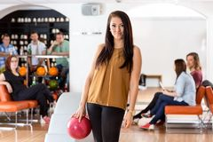 Beautiful Woman With Bowling Ball in Club Stock Images