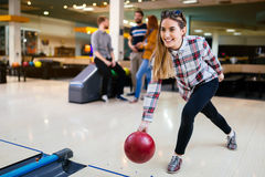 Beautiful woman bowling with friends Stock Images