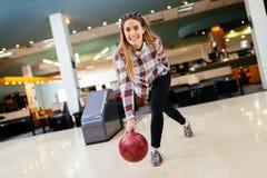Beautiful woman bowling Stock Images