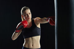 Beautiful woman is boxing on black background Royalty Free Stock Photos