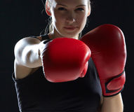Beautiful woman is boxing on gray background Royalty Free Stock Photo